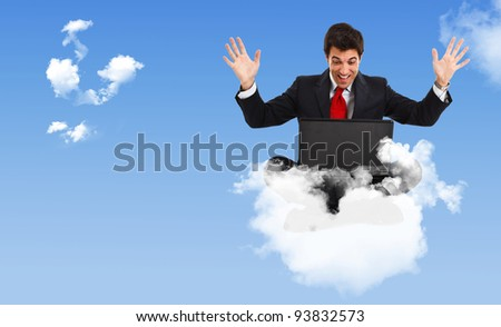 Happy businessman with a laptop sitting on a cloud