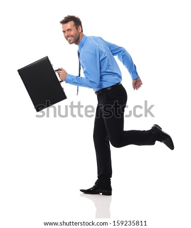 Happy businessman with briefcase running  - stock photo