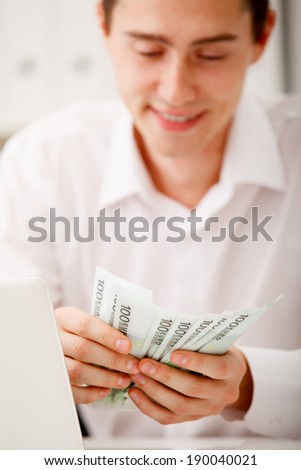 happy businessman with cash money - stock photo