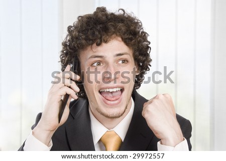 Happy businessman with cellular phone - stock photo