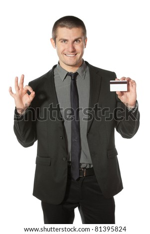 Happy businessman with credit card showing OK sign, isolated on white background - stock photo