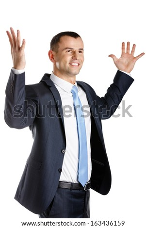 Happy businessman with hands up, isolated on white