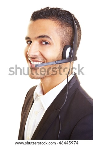 Happy businessman with headset on his head - stock photo