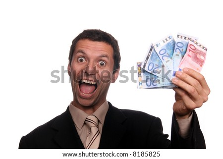 happy businessman with money (focus on the man) - stock photo