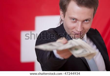 happy businessman with money over switzerland flag - stock photo