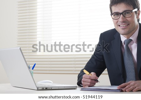 Happy businessman with paperwork - stock photo
