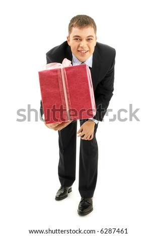 happy businessman with pink gift package over white - stock photo
