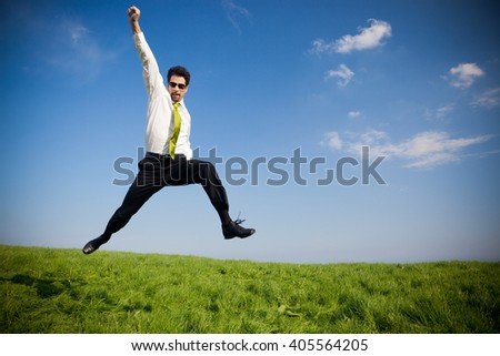 happy businessman with suitcase outdoor in a sunny day