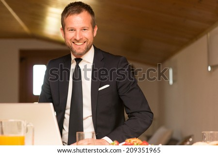 Happy businessman working at home