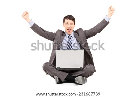 Happy businessman working on a laptop isolated on white background - stock photo