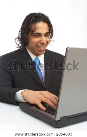 happy businessman working on laptop on white background - stock photo