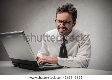 happy businessman working on the computer