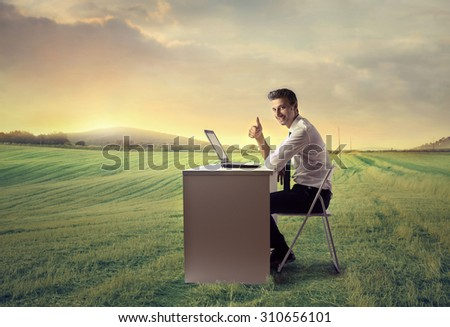 Happy businessman working outside