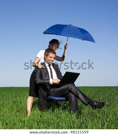 Happy businessmen working on laptop. Outdoors on a sunny day - stock photo