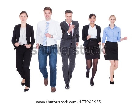 Happy Businesspeople In Group Running Over White Background - stock photo