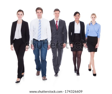 Happy Businesspeople In Group Walking Over White Background - stock photo