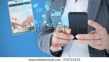 Happy businesswoman calling with smartphone against blue background
