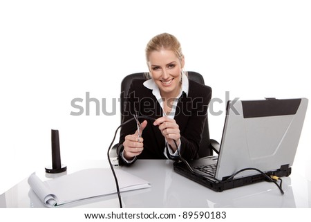 happy businesswoman cutting network cable - stock photo
