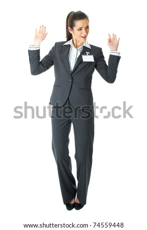 happy businesswoman dance, attractive brunette in grey suit isolated on white background - stock photo