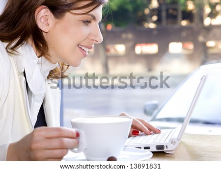 happy businesswoman drinking morning coffee and surfing internet - stock photo