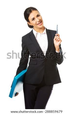 Happy businesswoman holding a pen. - stock photo