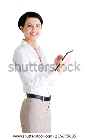 Happy businesswoman holding a tablet - stock photo