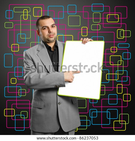 happy businesswoman holding blank white card in her hands - stock photo