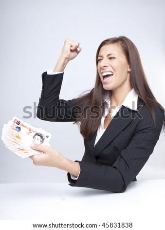 Happy Businesswoman Holding Money british pounds - stock photo