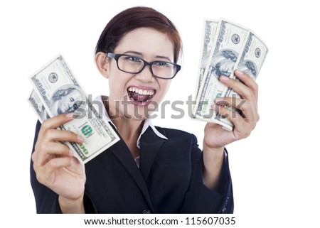 Happy businesswoman holding one hundred dollar bills