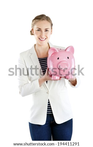 Happy businesswoman holding piggy bank against white background - stock photo