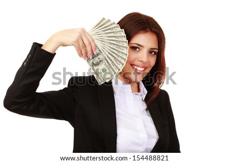 Happy businesswoman holding stack of dollars - stock photo