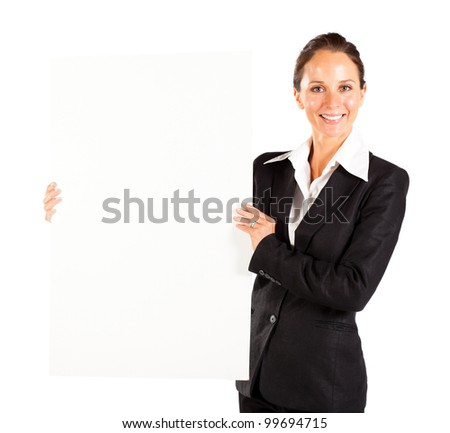 happy businesswoman holding white board
