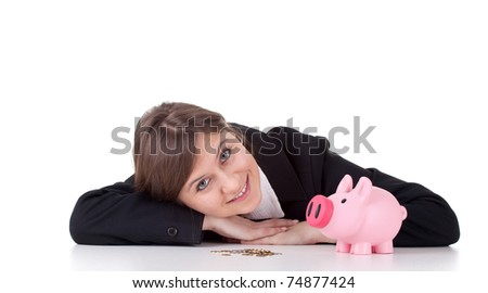 happy businesswoman in black suit, coins and piggy bank - stock photo