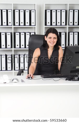 happy businesswoman in office - stock photo