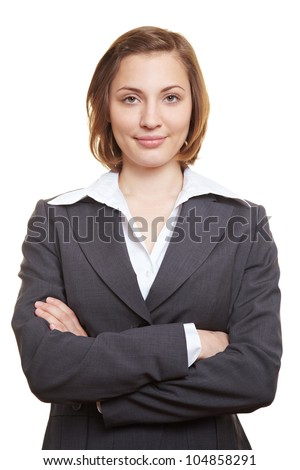 Happy businesswoman in suit with her arms crossed - stock photo