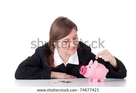 happy businesswoman inserting coin or changes into piggy bank, concept for saving money, investment - stock photo