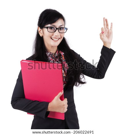 Happy businesswoman making an ok sign - isolated over a white background - stock photo