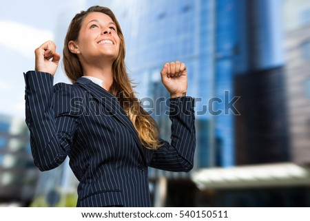 Happy businesswoman outdoor