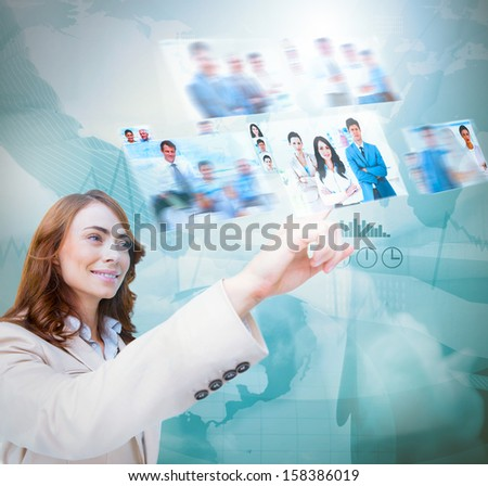 Happy businesswoman scrolling pictures on blue map background - stock photo