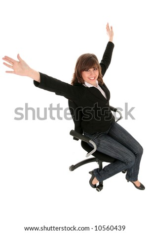 Happy businesswoman sitting on an office chair - stock photo