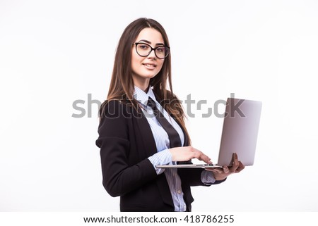 Happy businesswoman standing with laptop isolated on a white background. Looking at camera - stock photo