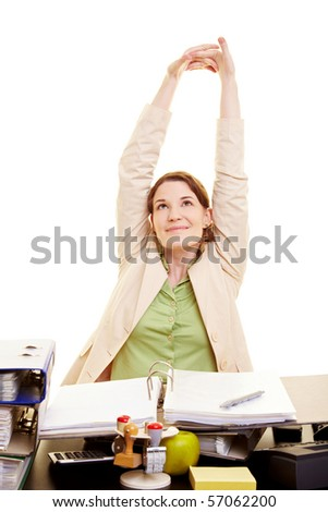 Happy businesswoman stretching her arms at her desk - stock photo
