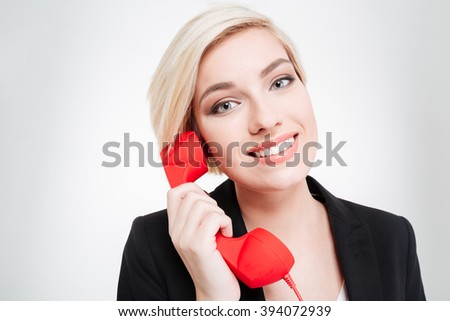 Happy businesswoman talking on the retro phone tube isolated on a white background - stock photo