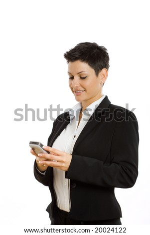 Happy businesswoman using mobile phone, smiling, isolated on white.