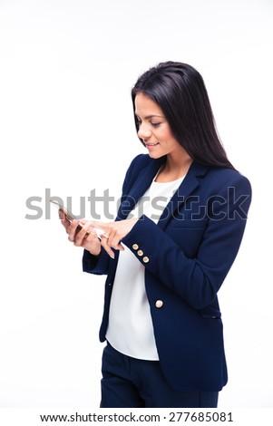 Happy businesswoman using smartphone over white background - stock photo