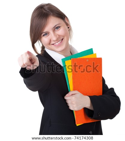 happy businesswoman with colorful folders smiling at camera pointing you - stock photo