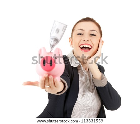 happy businesswoman with her savings in a piggy bank, white background - stock photo