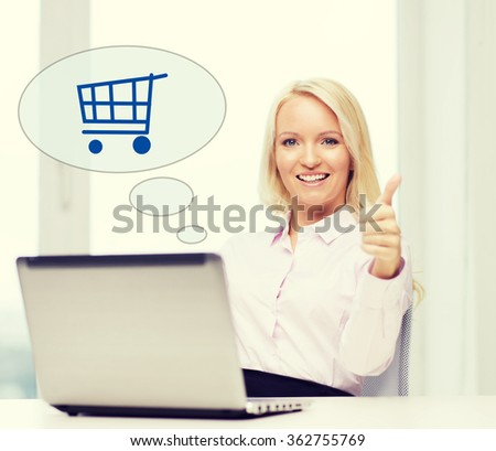 happy businesswoman with laptop showing thumbs up - stock photo
