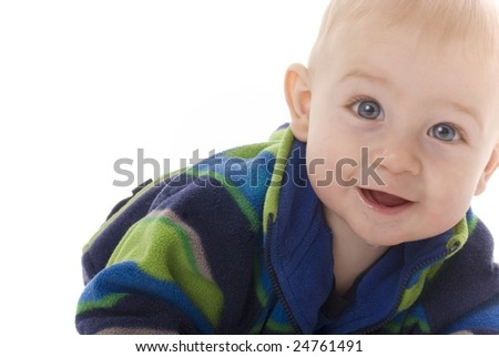 Happy but curious teething baby moves towards camera - stock photo