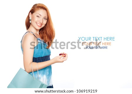 happy buyer. happy girl with shopping bag in blue dress over white background. Studio shot - stock photo